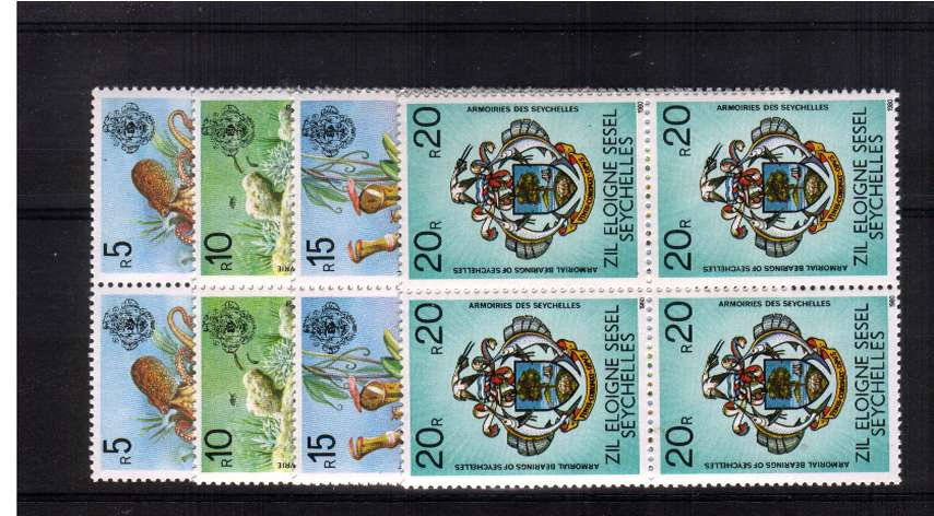 The top four values in superb unmounted mint blocks of four.