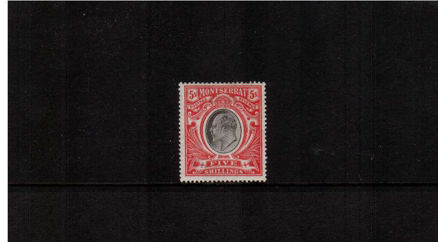 The 5/- Black and Scarlet - watermark Crown CC<br/>A fine lightly mounted mint stamp. SG Cat £150