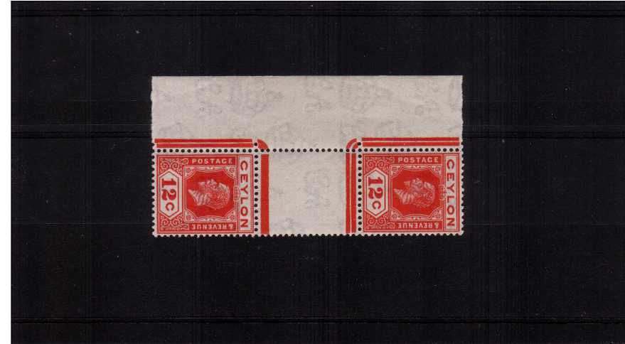 12c Rose-Scarlet. A superb unmounted mint vertical gutter pair showing Die I and Die II together. Rare to find with the bonus of being marginal and unmounted.