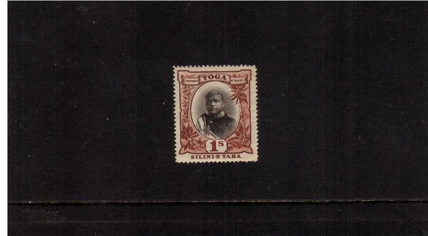1/- Black and Red good mounted mint.<br/>A fresh well centered stamp showing the variety ''No hyphen before TAHA''.
