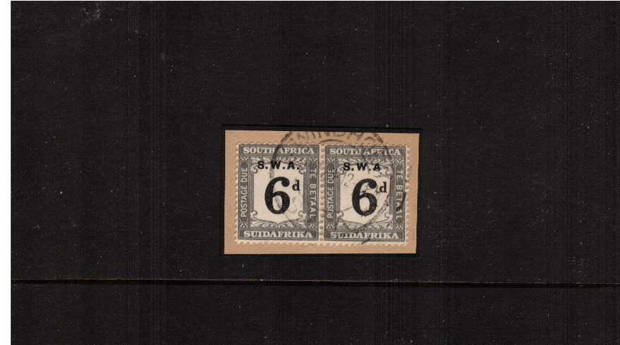 The 6d Black and Slate POSTAGE DUE as a pair on piece showing on the stamp at right the listed variety ''Without stop after ''A''  ''. A rare item.