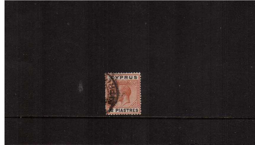 12pi Chestnut and Black - Multiple Crown.<br/>A good fine used single (no missing perfs at left - its the postmark!)