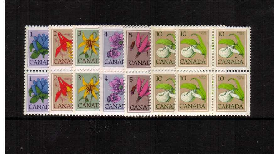 Flowers set of seven that includes the 10c perforation variation<br/>superb unmounted mint blocks of four. 
