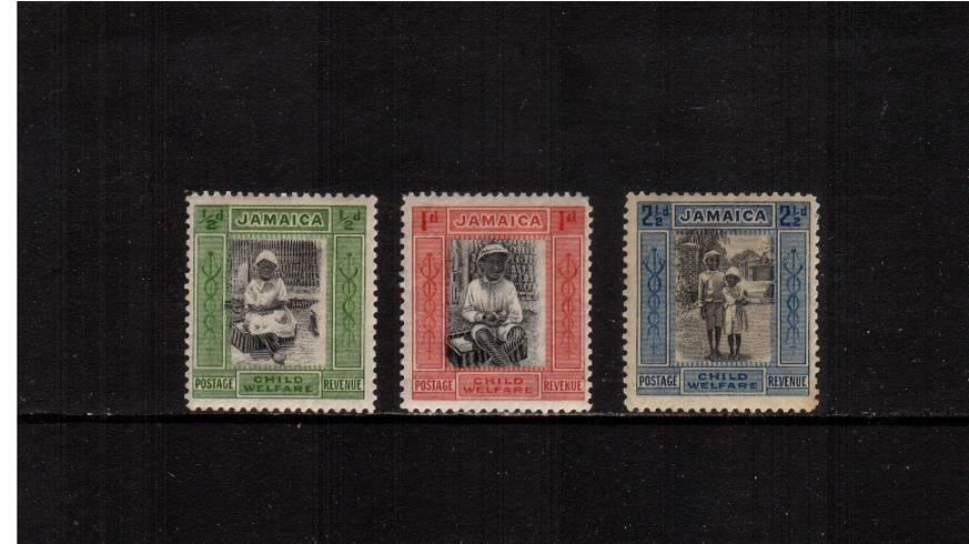 The Child Welfare set of three lightly mounted mint but with very minor faults.