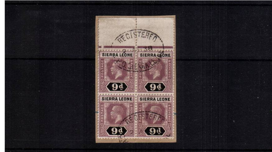A stunning top marginal block of four of the 9d value cancelled with two light strikes of on oval REGISTERED handstamp tied to a small piece. Lovely! SG Cat for singles �0