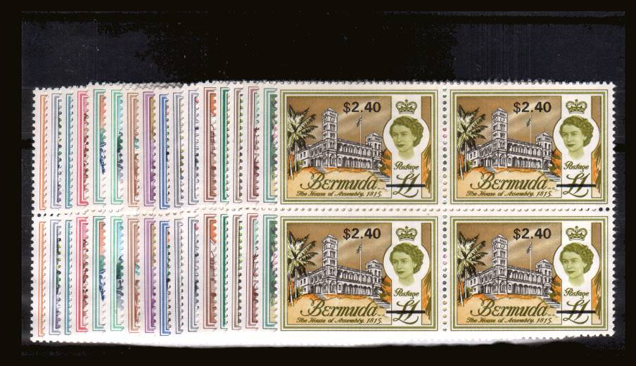 The surcharged set of seventeen in superb unmounted mint mint blocks of four.