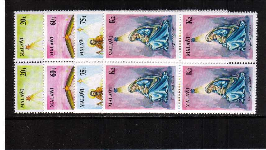 Christmas set of four in superb unmounted mint blocks of four.